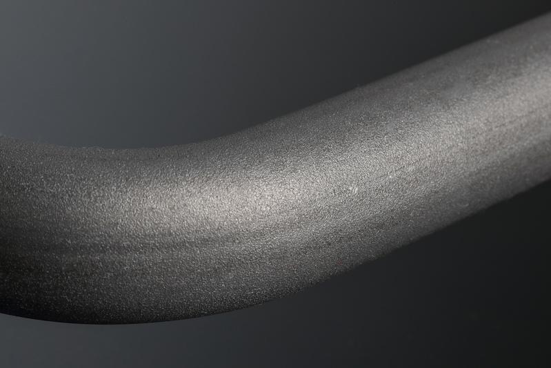 熱処理 → セッチング → ショットピーニングの順に工程を重ねていくことで、許容荷重と耐疲労性の向上を図る。